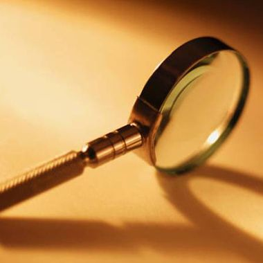Who invented  the Magnifying Glass?