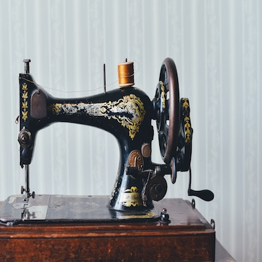 Who invented sewing machine?